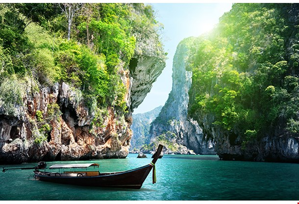 Long Boat And Rocks On Railay Beach In Krabi Thailand