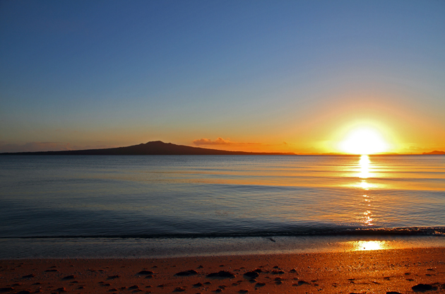 the-dawn-of-a-new-day-as-the-sun-rises-beside-rangitoto-island-The Dawn Of A New Day As The Sun Rises Beside Rangitoto Island