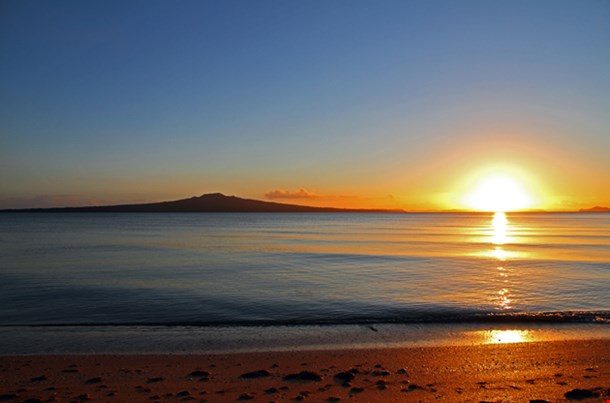 The Dawn Of A New Day As The Sun Rises Beside Rangitoto Island