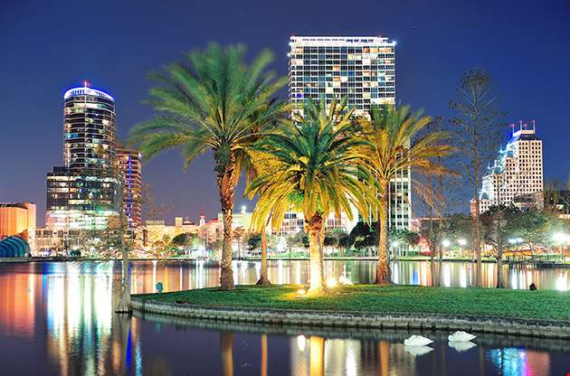 orlando-downtown-skyline-panorama-over-lake-eola-at-night-Orlando Downtown Skyline Panorama Over Lake Eola At Night