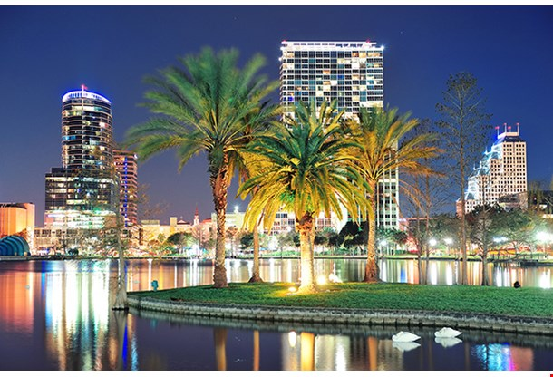 Orlando Downtown Skyline Panorama Over Lake Eola At Night