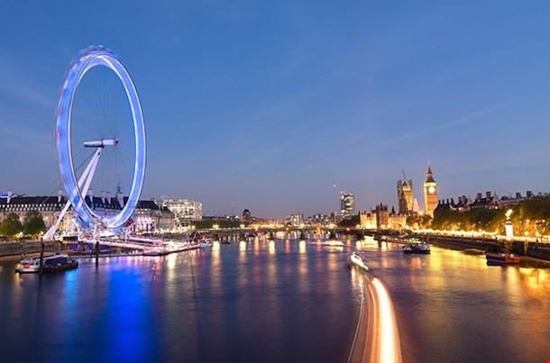 London Eye And Big Ben On The Banks Of Thames River