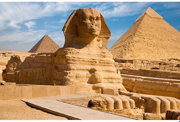 Great Sphinx Including The Pyramids Of Menkaure And Khafre In The Background In Giza Cairo Egypt