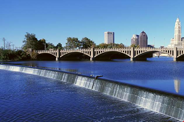 Scioto River With Waterfall And Columbus In Ohio-Scioto River With Waterfall And Columbus In Ohio