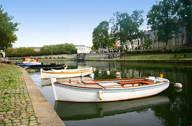 Row Of Boats Moored In A City Lake Of Nantes France