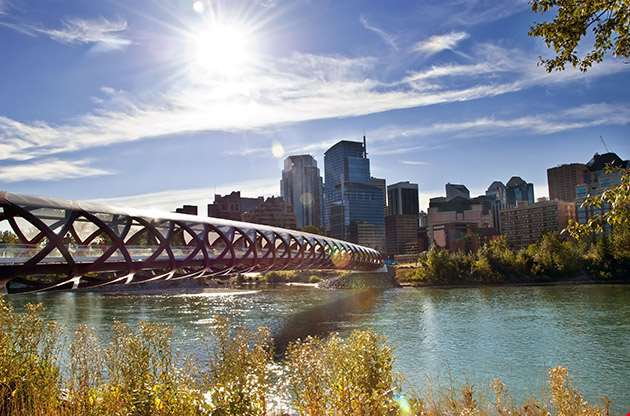 A Pedestrian Bridge Across Bow River In Calgary-A Pedestrian Bridge Across Bow River In Calgary