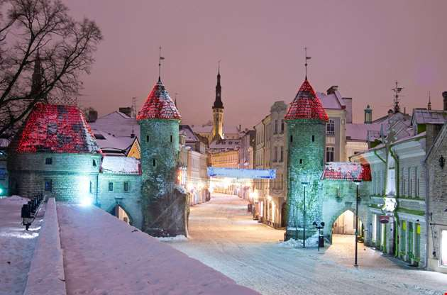 snowy-nighttime-old-city-of-tallinn-Snowy Nighttime Old City of Tallinn