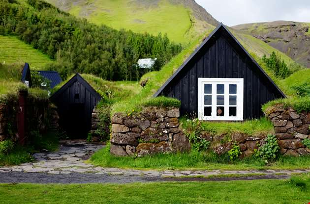 traditional-icelandic-house-with-grass-roof-in-skogar-folk-museum-iceland-Traditional Icelandic House With Grass Roof in Skogar Folk Museum Iceland