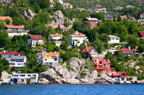 Houses And Huts On The Shore And Hills Of Bergen Fjord