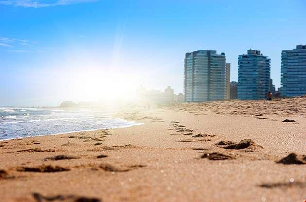 golden-sand-on-sunny-beach-of-atlanctic-ocean-montevideo-Golden Sand On Sunny Beach Of Atlanctic Ocean Montevideo
