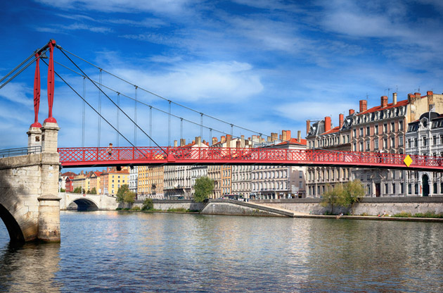 red-footbridge-in-lyon-with-saone-river-Red Footbridge in Lyon with Saone River